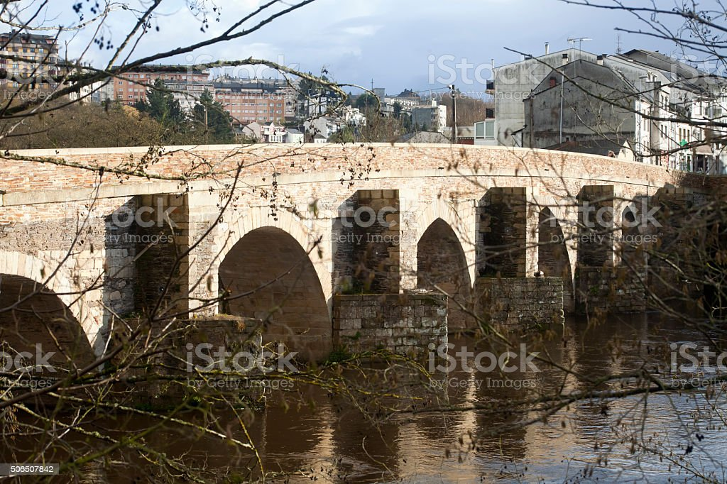 Ancient stone bridge in Lugo, Galicia, Spain. stock photo