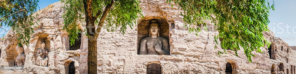 Ancient stone Buddhas carved into rock grottoes at Yungang China stock photo