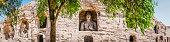 Ancient stone Buddhas carved into rock grottoes at Yungang China