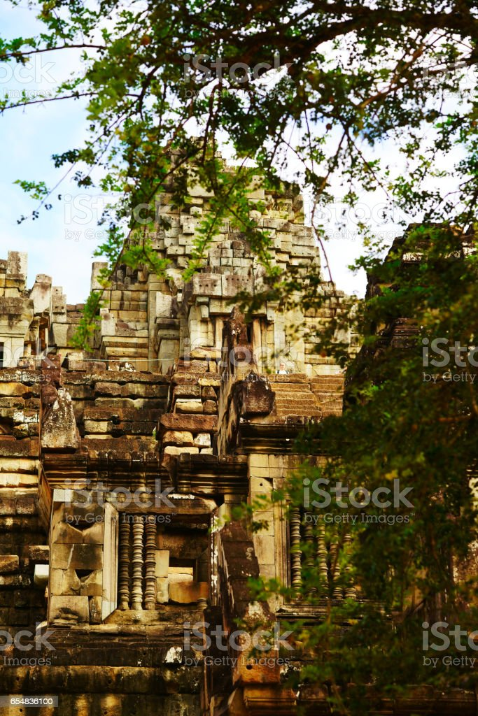 Ancient stone carving in one of the beautiful temples of Angkor, Cambodia stock photo