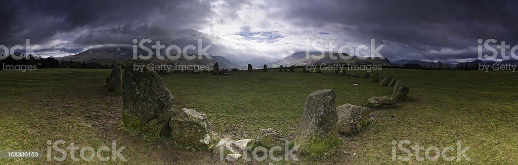 Ancient stone circle dramatic mountain cloudscape Castlerigg Lake District UK stock photo