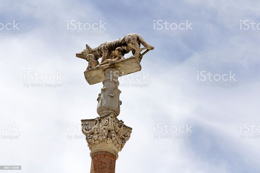 Ancient stone figure with Romulus and Remus stock photo