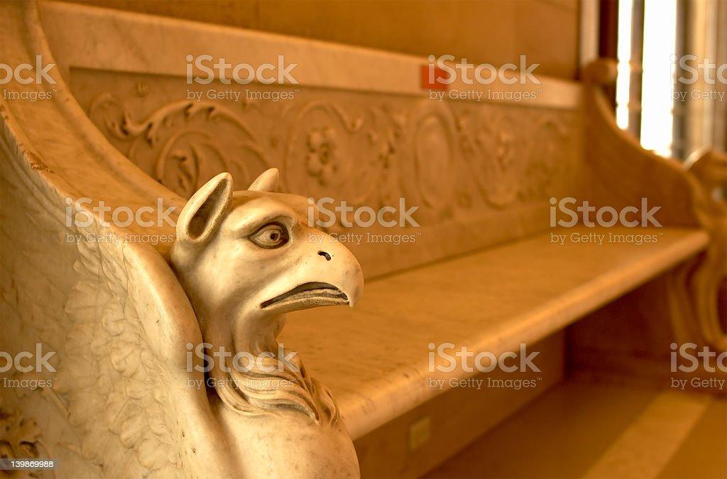 Ancient stone gargoyle stock photo