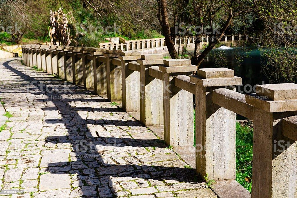Ancient stone promenade with stone railing stock photo