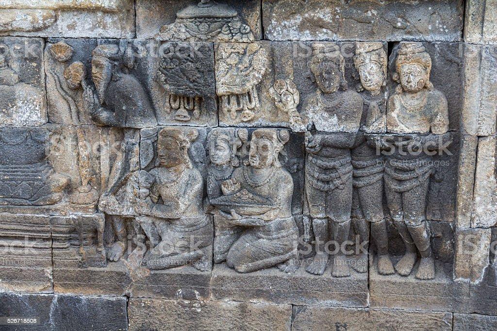 Ancient stone reliefs in Borobudur temple stock photo
