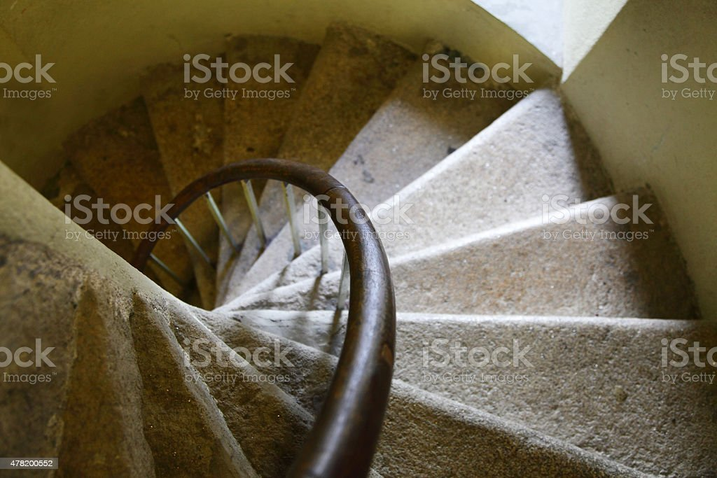 ancient stone spiral stairwell stock photo