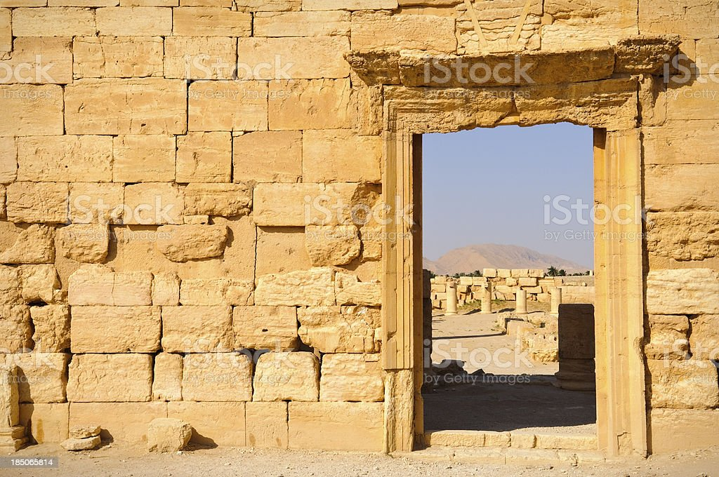 Stone wall and doorway in Palmyra Syria royalty-free stock photo