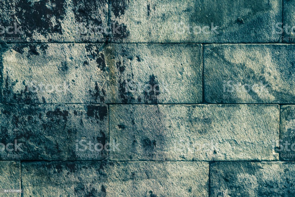 Ancient stone wall, background, texture - vintage toning stock photo