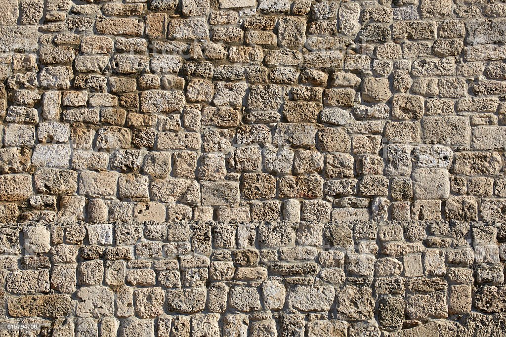 Ancient stone wall of the amphitheater stock photo
