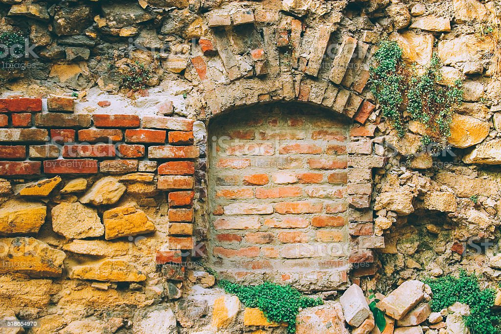 Ancient stone-brick wall with old window stock photo