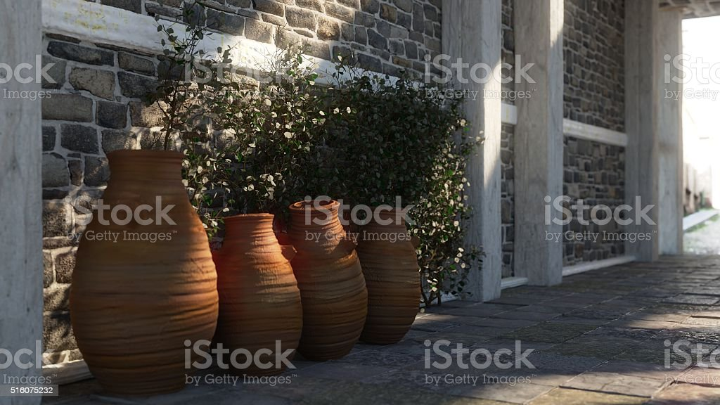 Ancient street with shadows, pitchers and plant stock photo