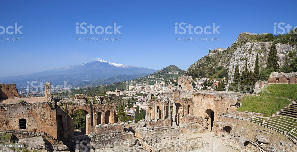 Ancient Teatro Greco in Taormina and Mount Etna, Sicily Italy stock photo