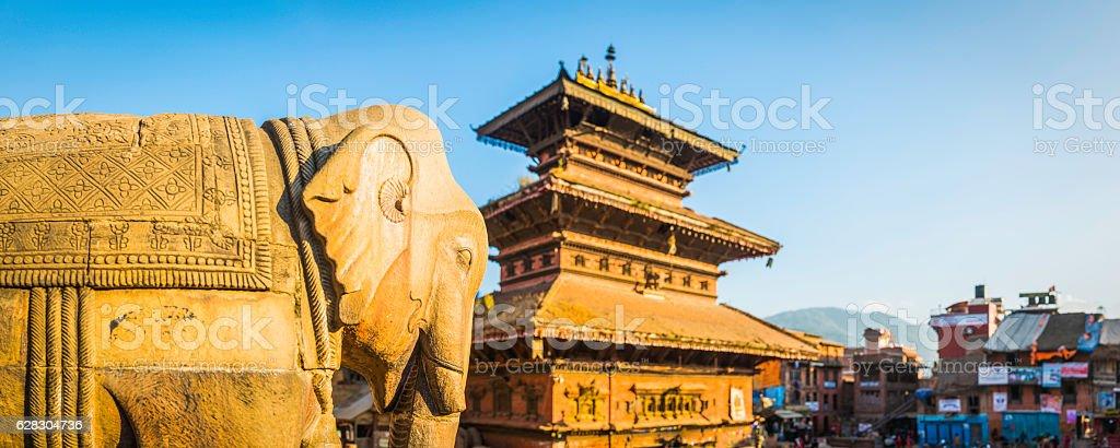 Ancient temples and elephant statues overlooking square Bhaktapur Kathmandu Nepal stock photo
