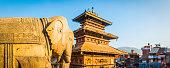 Ancient temples and elephant statues overlooking square Bhaktapur Kathmandu Nepal