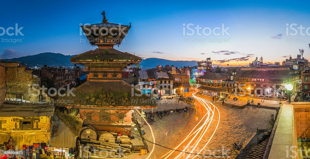 Ancient temples cobbled square zooming lights panorama Bhaktapur Kathmandu Nepal stock photo