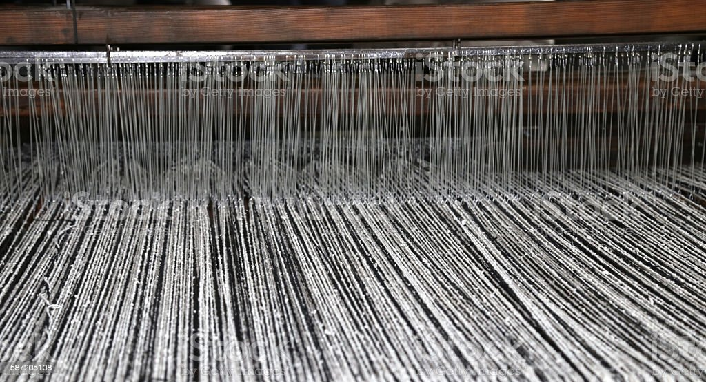 ancient textile loom of wood with black and white stock photo