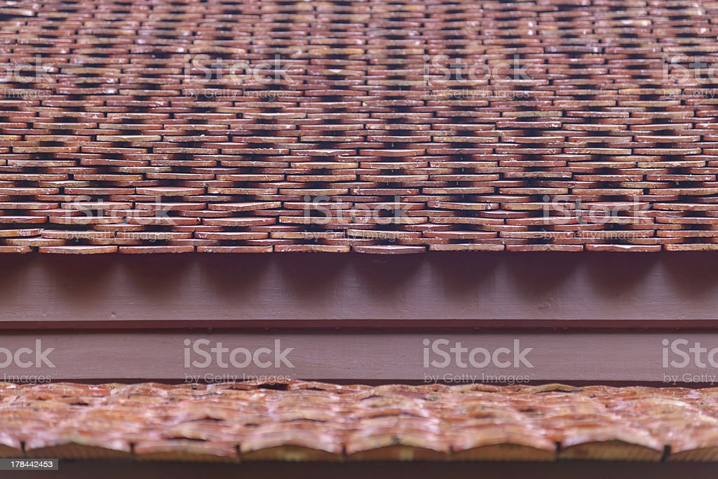 Ancient thai style roof made from clay tiles royalty-free stock photo