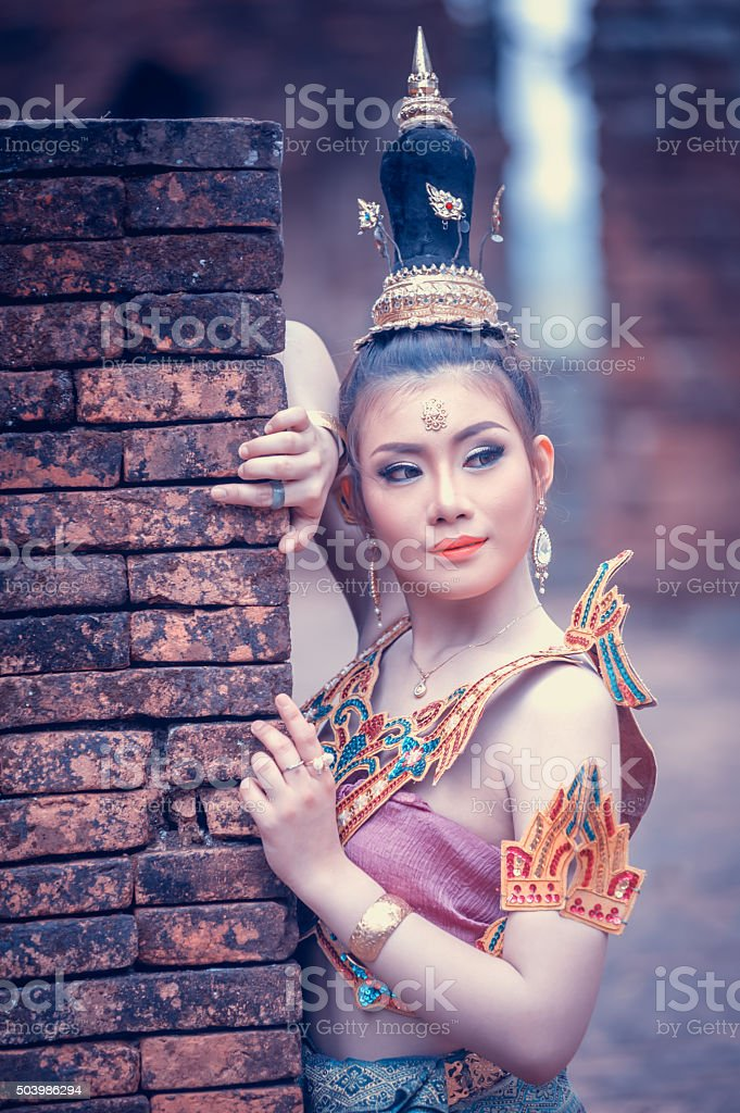 ancient Thai Woman In Traditional Costume Of Thailand stock photo