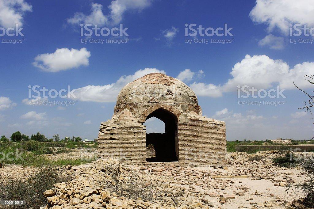 Ancient tomb in Makli hill graveyard, Beautidul Blue Skys stock photo