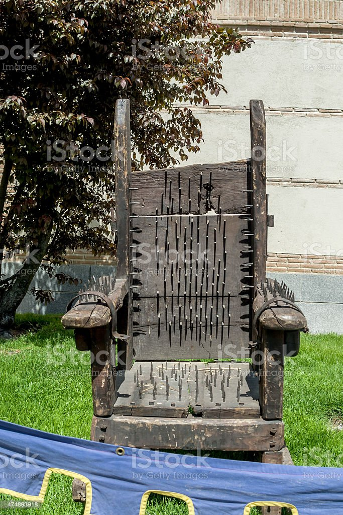 ancient tortures chair stock photo