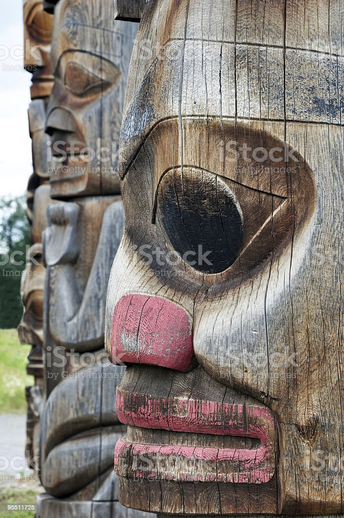 ancient totem poles stock photo