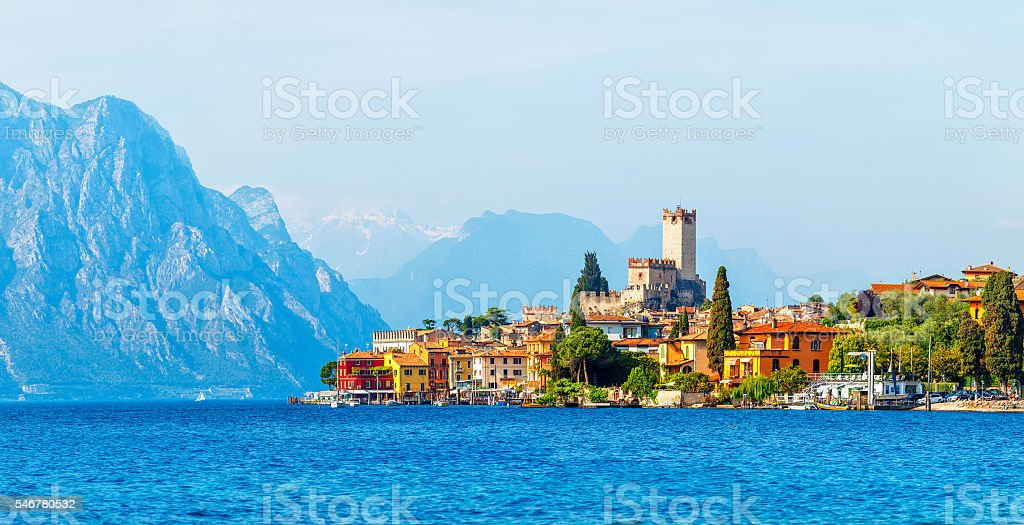 Ancient tower and colorful houses in malcesine old town stock photo