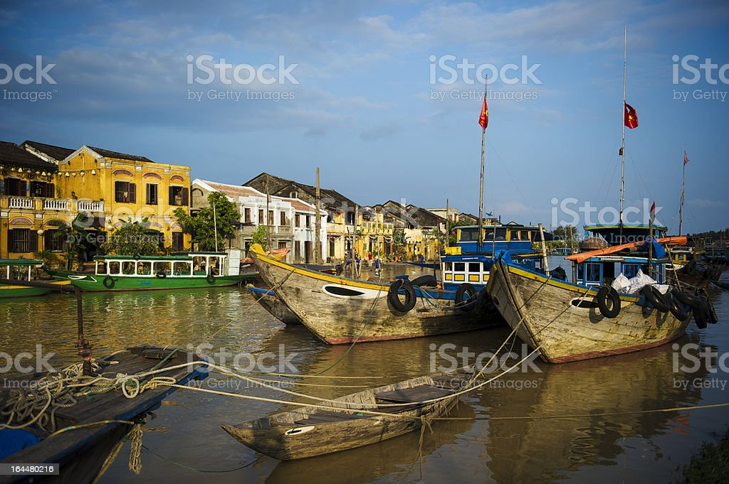 Ancient town viewed from the river with fishingboats at foreground royalty-free stock photo