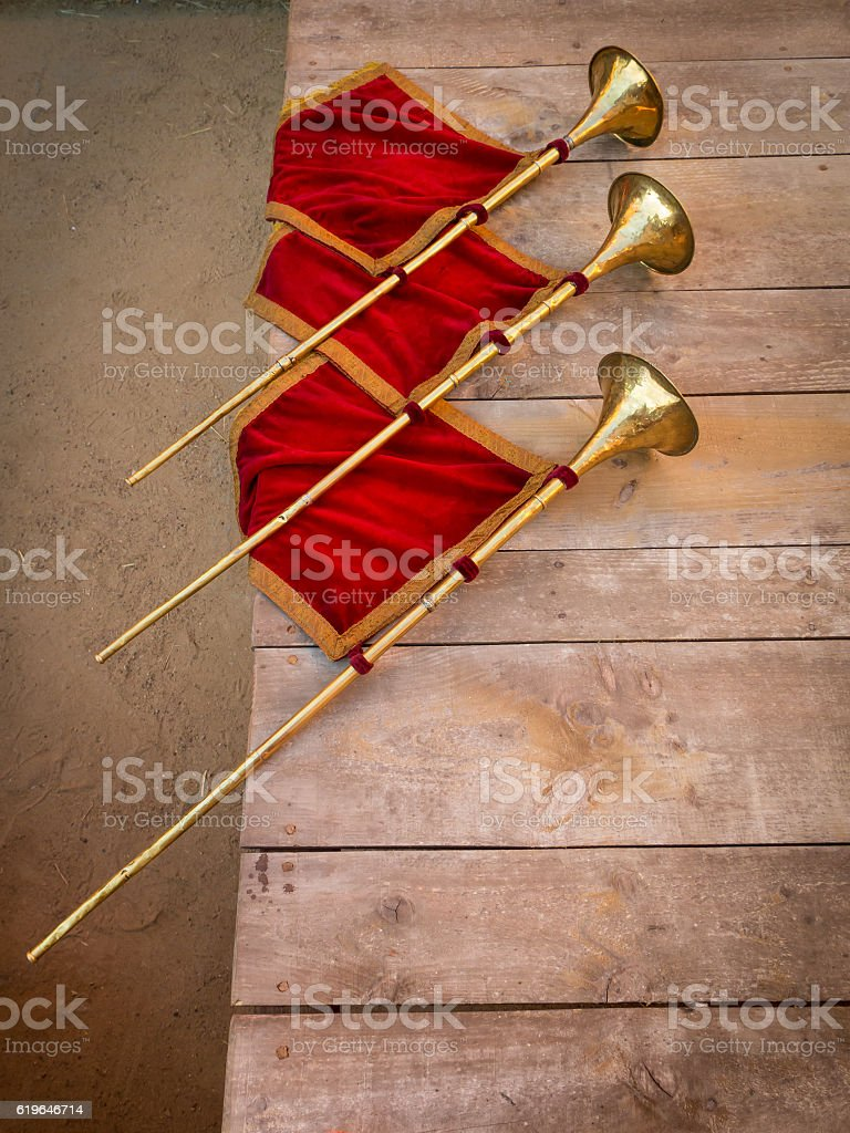 Ancient trumpets made of brass and copper stock photo