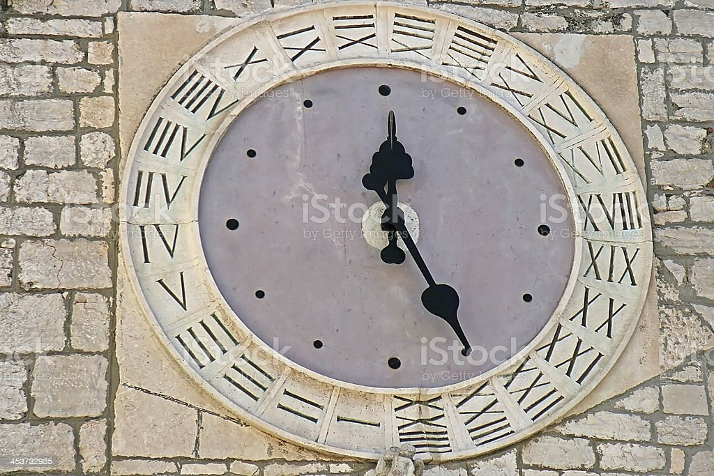 ancient twenty four hours clock face stock photo