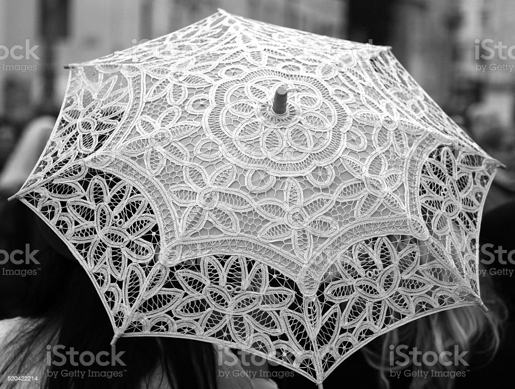 ancient umbrella all hand-decorated with lace doilies stock photo