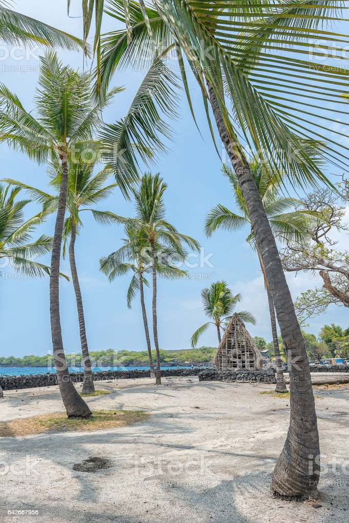 Ancient village of Hawaiin at Pu'uhonua O Honaunau National Historical Park stock photo
