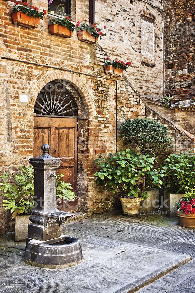Ancient Village View with Fountain and Plants, Val d'Orcia stock photo