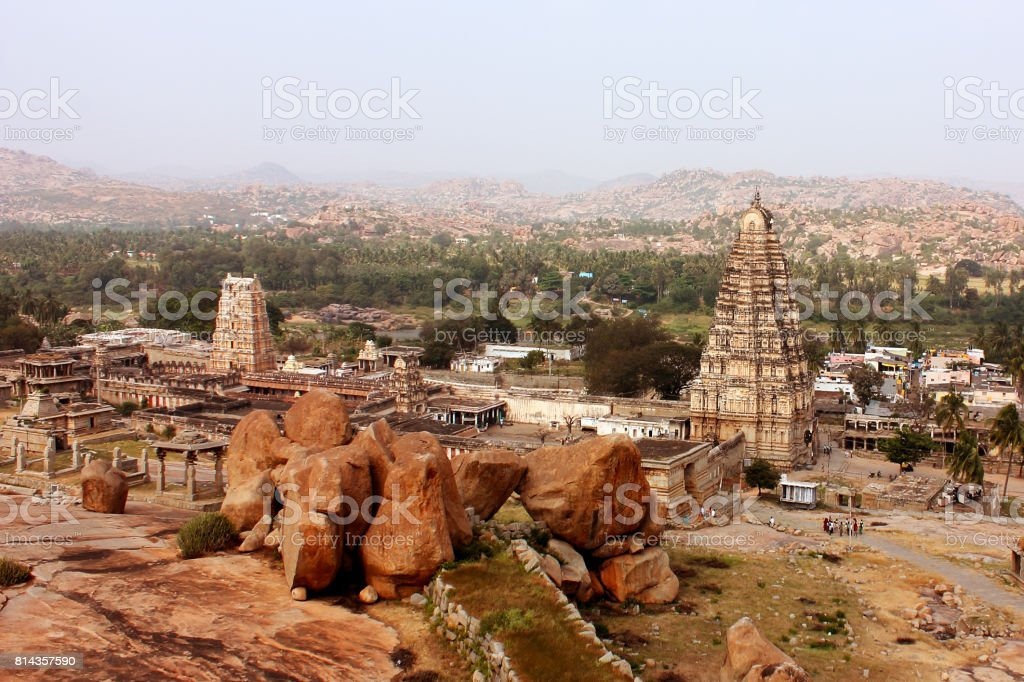 Ancient Virupaksha temple with ruins in Hampi, India stock photo