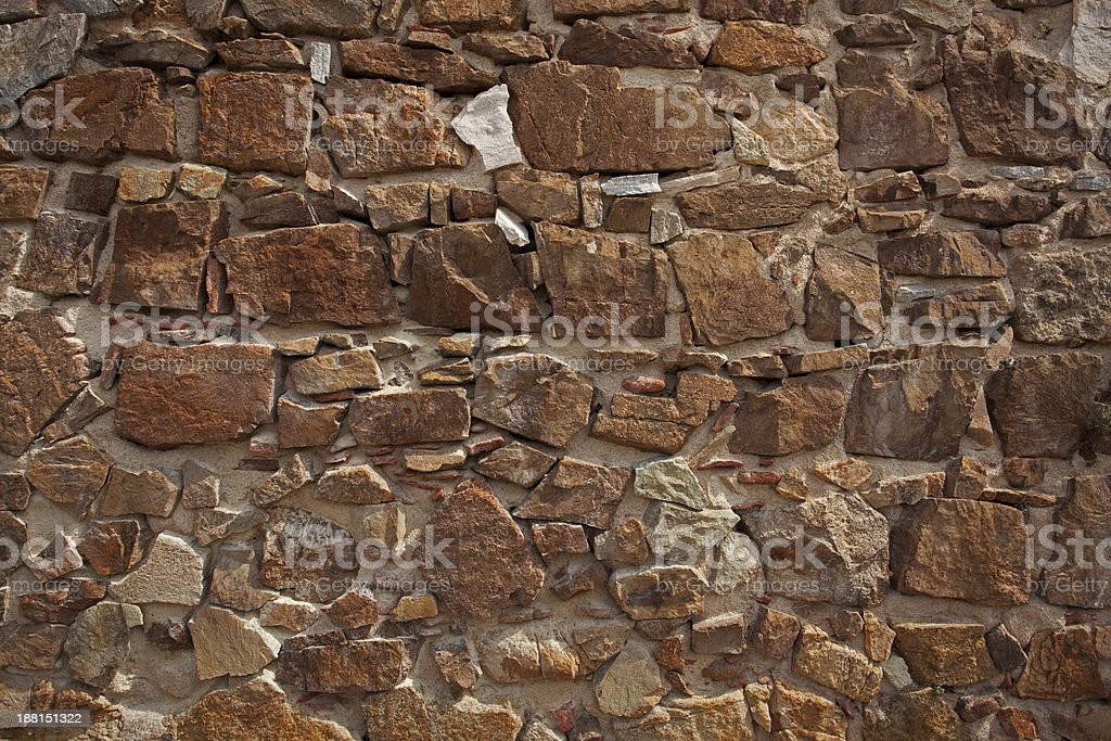 Ancient wall made of many bricks royalty-free stock photo