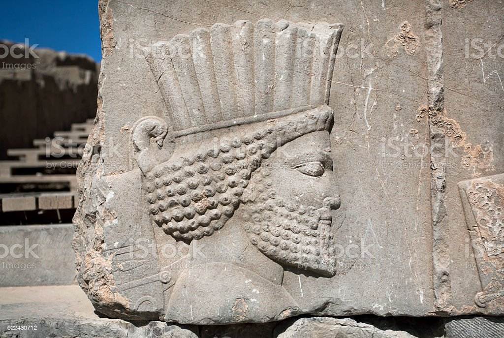 Ancient warrior, destroyed bas-relief in Persepolis stock photo