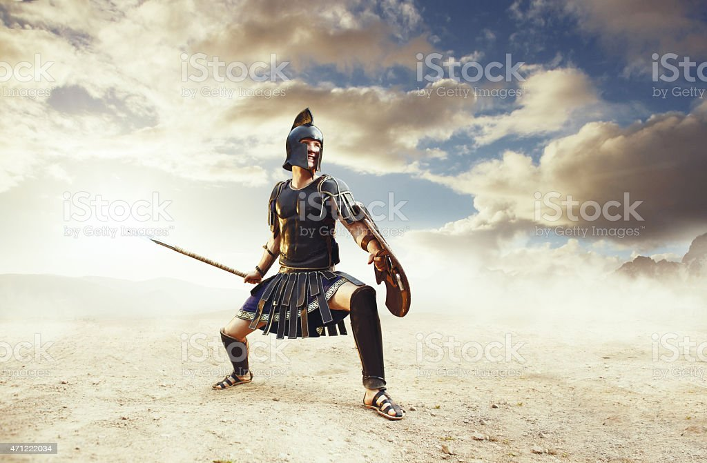 Ancient warrior in a typical black costume holding a spear stock photo