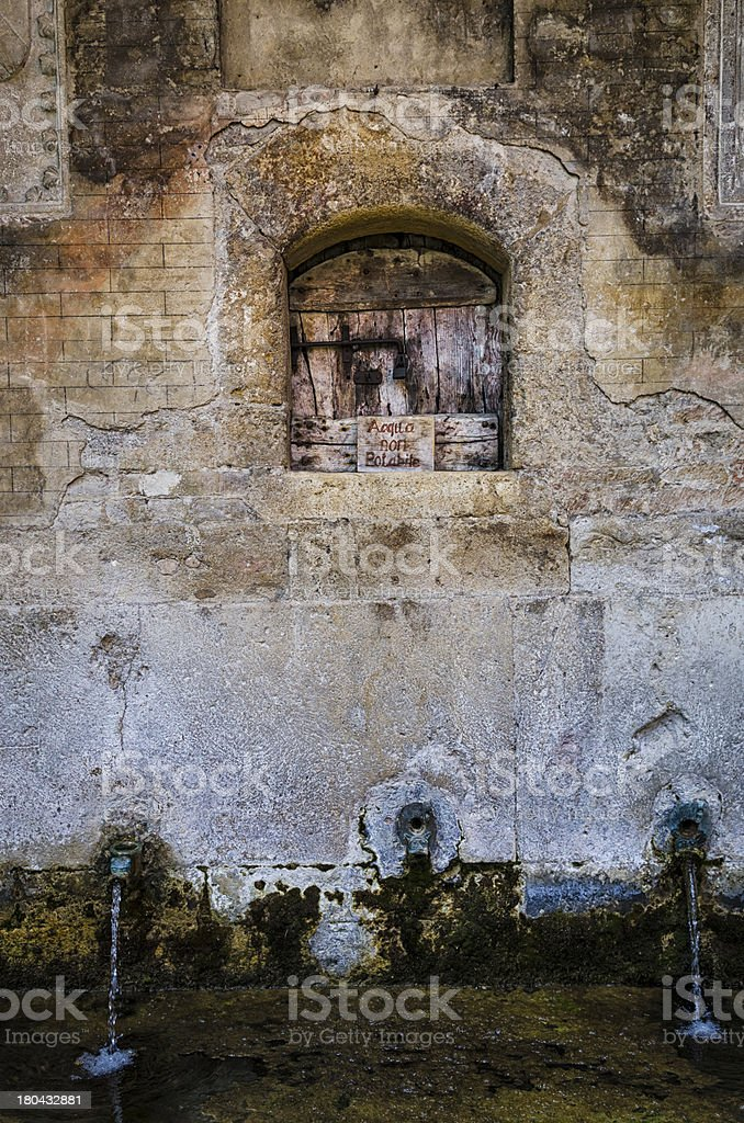 ancient water source with rusted lock royalty-free stock photo