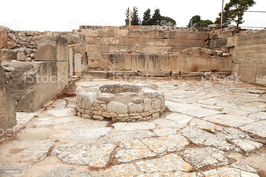 Ancient water well in Faistos stock photo