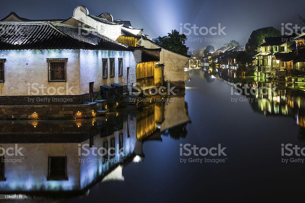 Ancient Watertown in China at night, Wuzhen Shanghai  houses stock photo