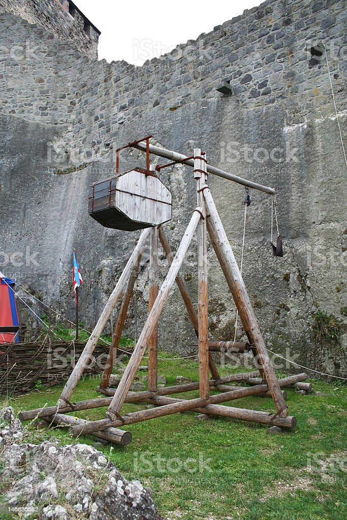 Ancient weapon at castle walls stock photo