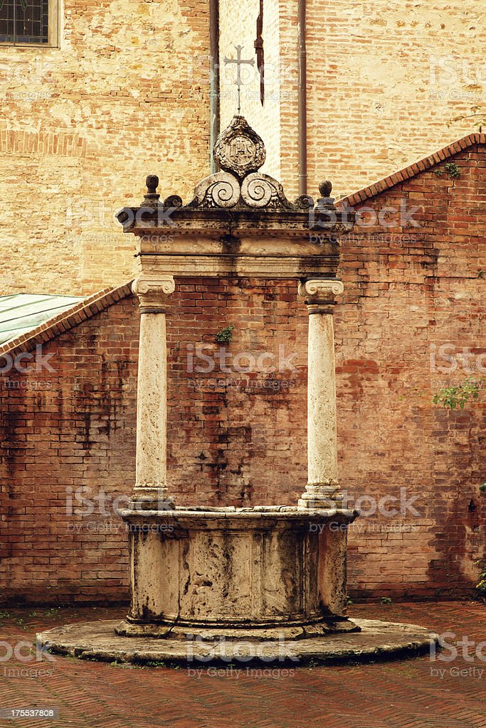 Ancient well in Siena, Tuscany, Italy stock photo