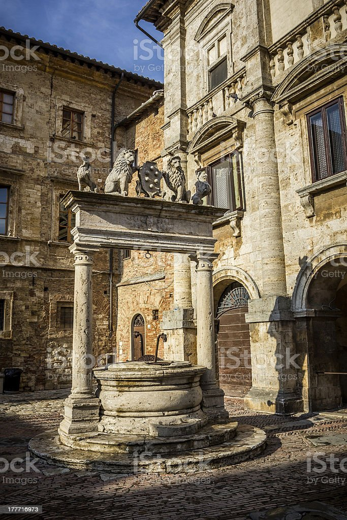 Ancient well on Piazza Grande square in Montepulciano, Tuscany, Italy stock photo