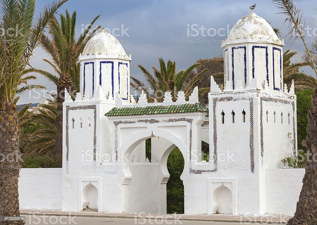Ancient white gate to the park in Tangier, Morocco stock photo