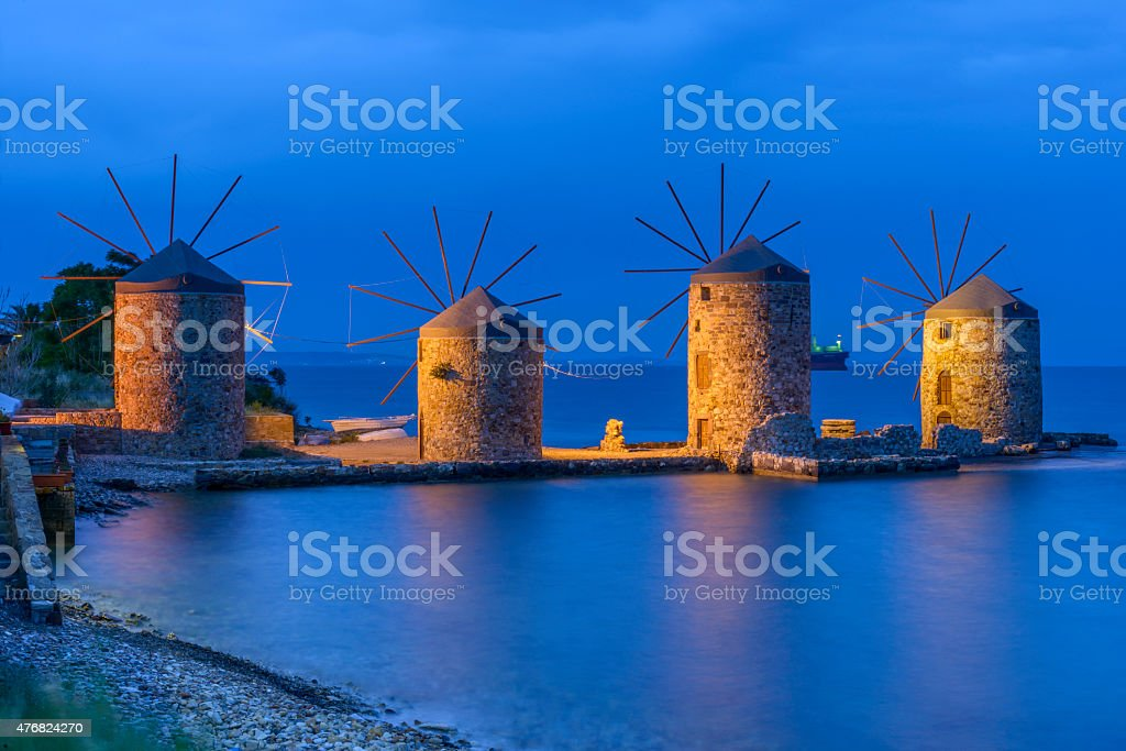 Ancient windmills of chios at night stock photo
