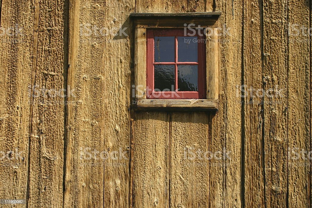 Ancient window of a wooden house stock photo