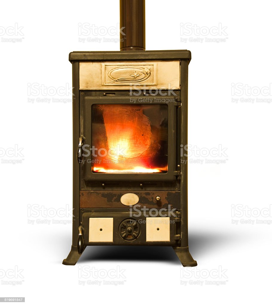 Ancient wood  burning stove with fire isolated on white background stock photo