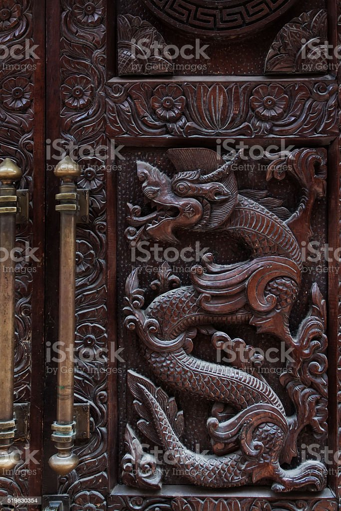 Ancient wooden door in Kathmandu stock photo