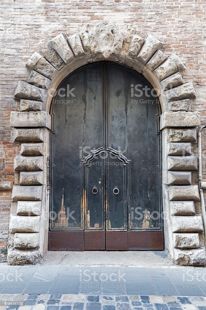 Ancient wooden gate in Rimini, Italy stock photo