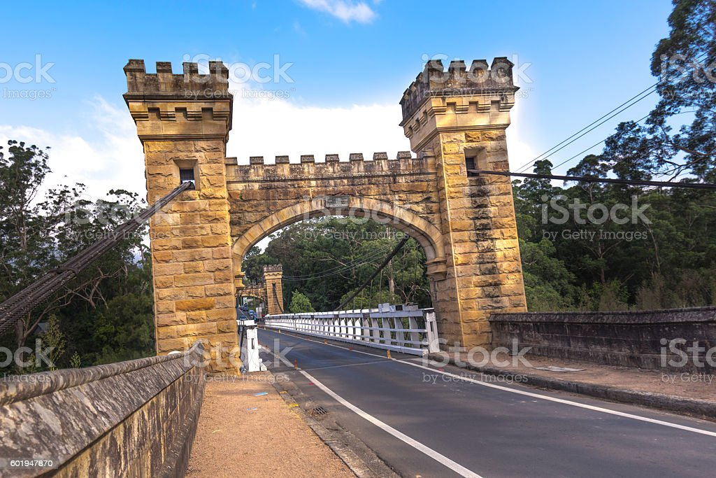 Ancient wooden suspension bridge. stock photo