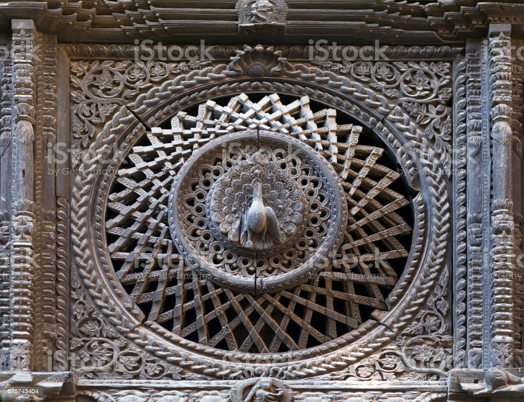 Ancient wooden window in Pujari Math palace in Bhaktapur, Nepal stock photo